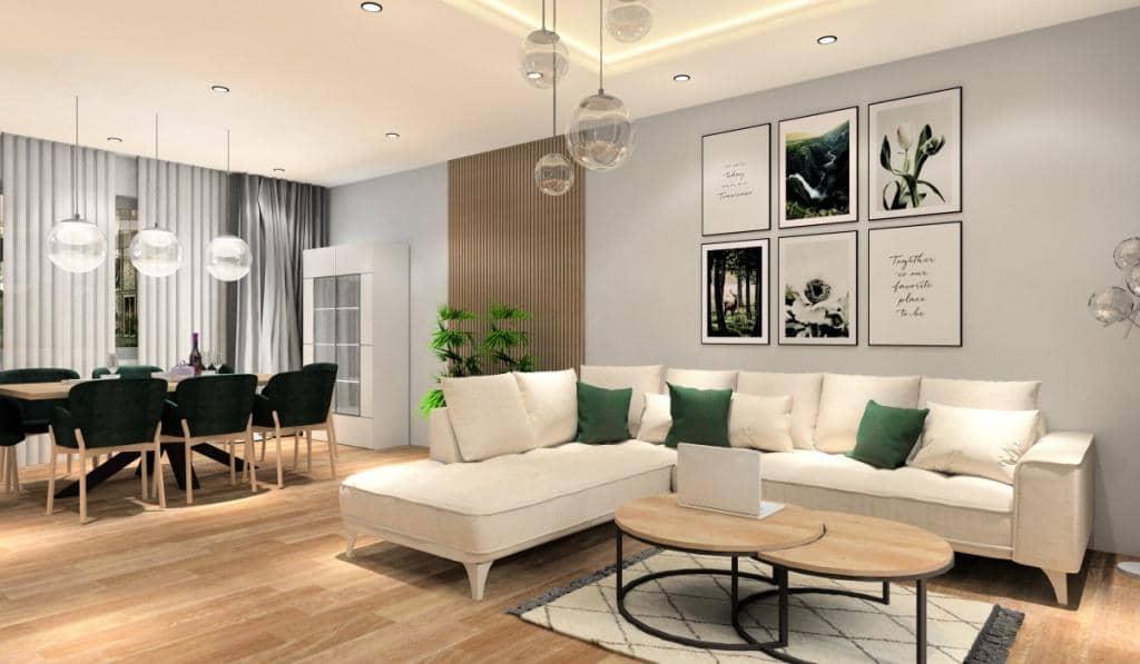 salon z jadalnią, aranżacja, duzy narożnik, duzy stół, ściana RTV z dużą szafką, podwieszany sufit, plakaty na ścianie za sofą