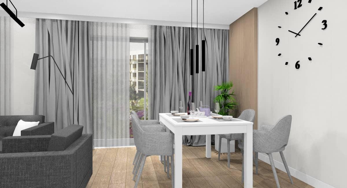 Wystrój salonu, czarne lamy na suficie, stół biały, krzesła tapicerowane, zegar na ścianie , panele drewniane na ścianie