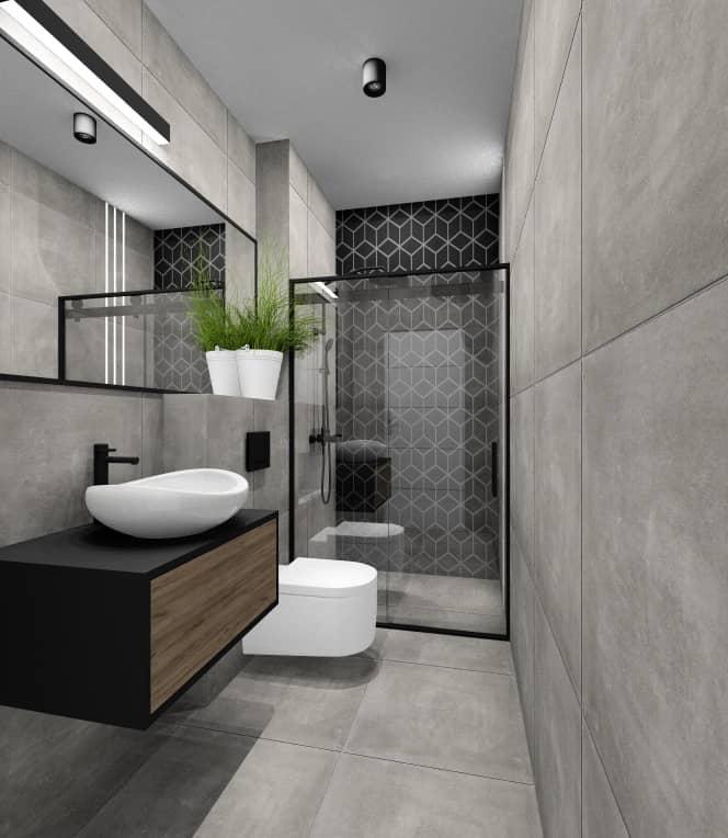 Łazienka w mieszkaniu 100  m2, czarne płytki pod prysznicem, szare płytki na podłodze, duże lustro w czarnej ramie