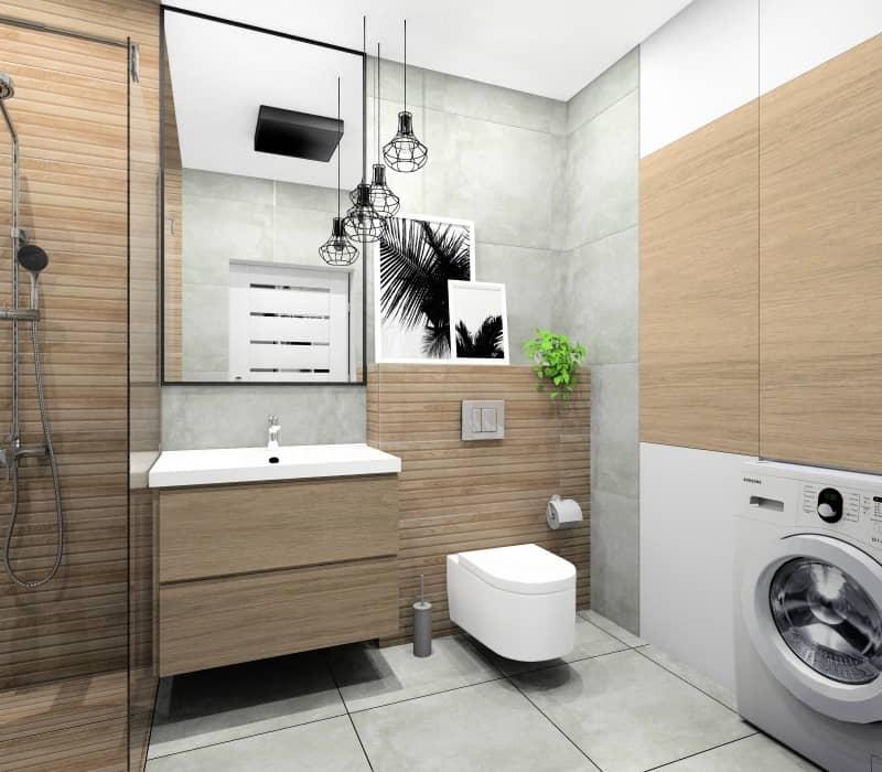Łazienka w bloku, mieszkanie 50 m2, widok na szafke pod umywalkę drewnianą, zabudowę wc drewnianą, szare płytki na ścianie, lustro prostokątne w czarnej ramie, plakaty nad wc, kwiaty, przytulne wnętrze