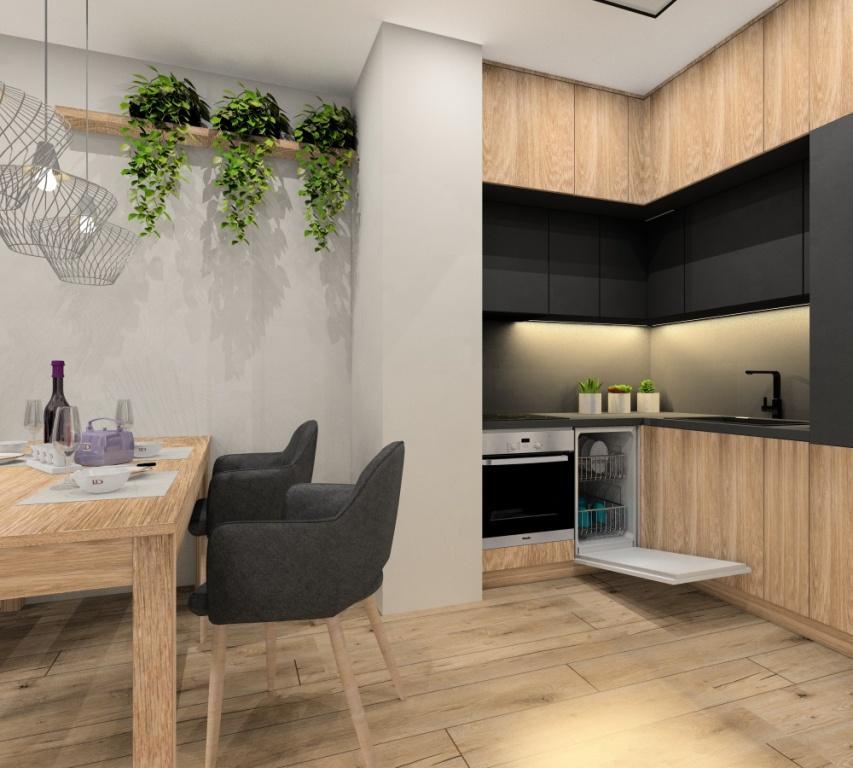 Mieszkanie 43 m2, mieszkanie dwupokojowe, aneks kuchenny, szafki górne, grafit drewni, szary, szafki dolne drewniane, szkło na ścianie matelak grafitowy, piękna ściana z kwiatami