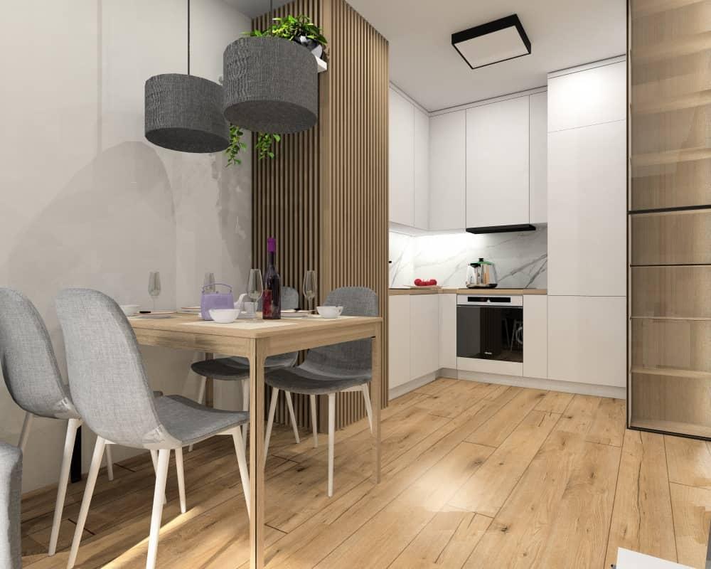 Salon z aneksem kuchennym i przedpokój w małym mieszkaniu