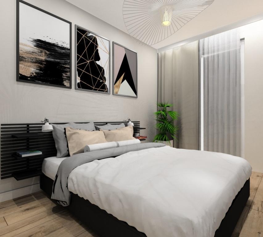 Sypialnia, mieszkanie dwupokojowe, mieszkanie 43m2, łózko z panelami na ścianie grafitowe, plakaty nad łóżkiem, pomysł na aranżację sćiany z łóżkiem, białe lampy