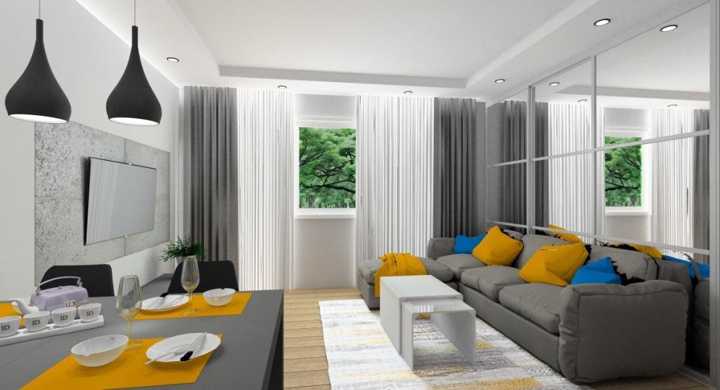Nowoczesny salon z kuchnią – nowoczesne wnętrze z jakimi dodatkami?, dodatki, miodowe poduszki, niebieskie poduszki, szary narożnik, miodowy szary biały dywan, miodowe podkładki pod talerze, szare zasłony