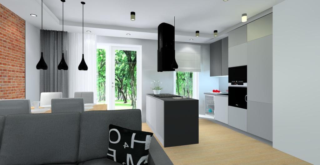 Salon z kuchnią nowoczesny, cegła na ścianie w salonie, kuchnia szara i grafit