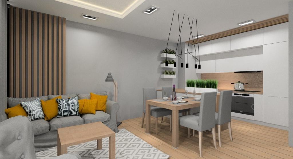 projekt salonu z kuchnią i jadalnią, aranżacja ściany w drewnie za sofą, biała kuchnia do sufitu z drewnem, wyspa w kuchni ze stołem, nowoczesne oświetlenie nad stołem, sufit podwieszany w salonie i w kuchni