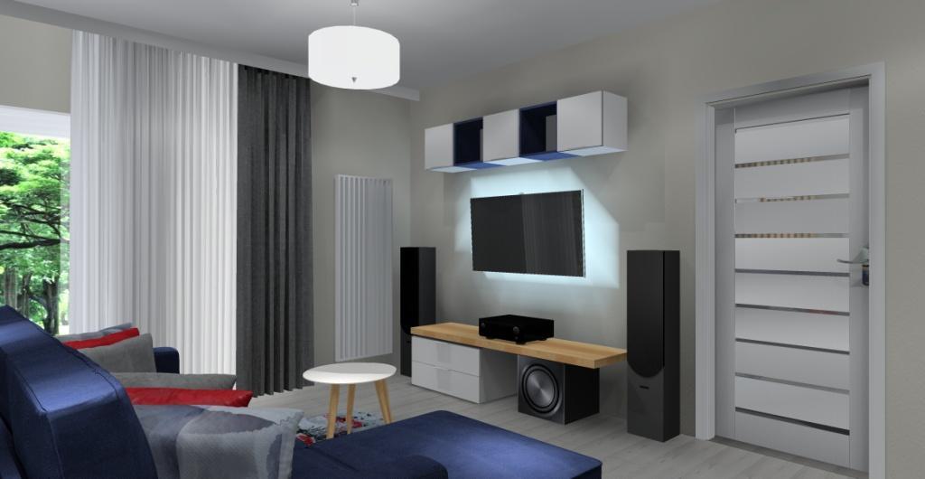 Projekt salonu z kuchnią, biała i drewniana szafka RTV, granatowa kanapa, biały stolik kawowy, szare zasłony