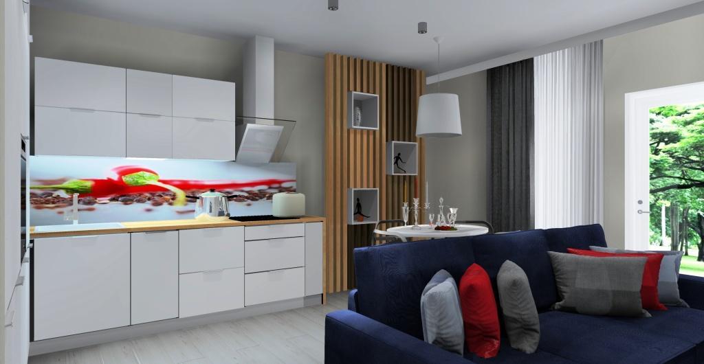 Salon z kuchnią, biała kuchnia z blatem drewnianym, kanapa granatowa, czerwone poduszki