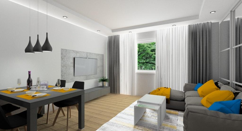 Zdjęcie nowoczesnego salonu z kuchnią, miodowe dodatki, beton na ścianie, grafitowy stół, nowoczesne czarne krzesła