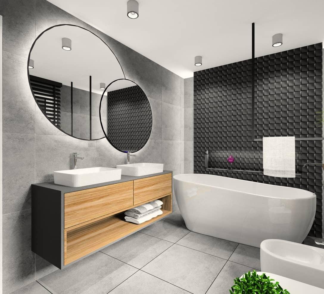 łazienka, urządzona jest w stylu nowoczesnym w kolorach szary i czarny z dodatkiem drewna, Duże okrągłe dwa lustra, wanna wolnostojąca, dwie umywalki