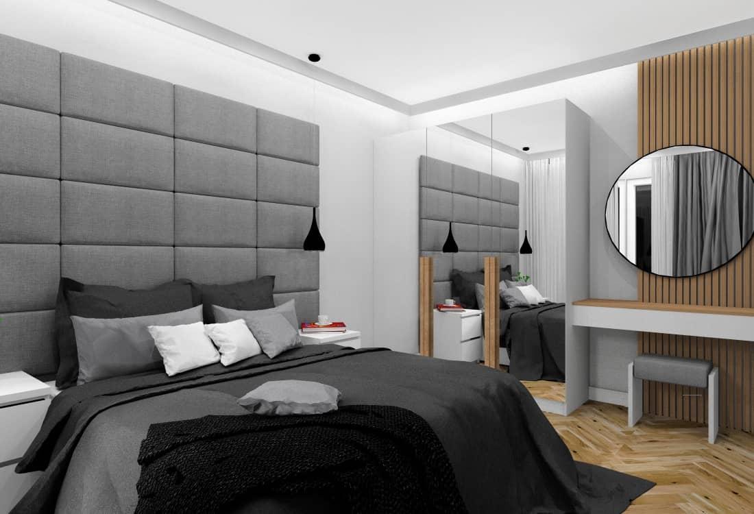 Mała sypialnia, biel szarość, drewno, łózko z zagłówkiem tapiecerowanym , szafa z lustrami, toaletka