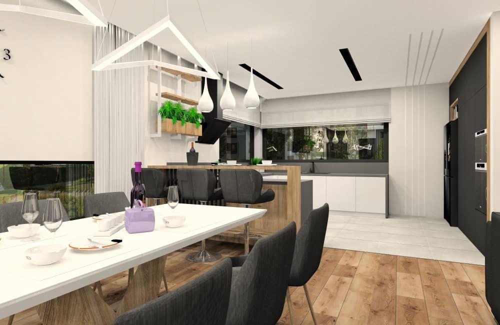 Aranżacja salonu z kuchnią. Kuchnia z oknem narożnym otwarta na salon