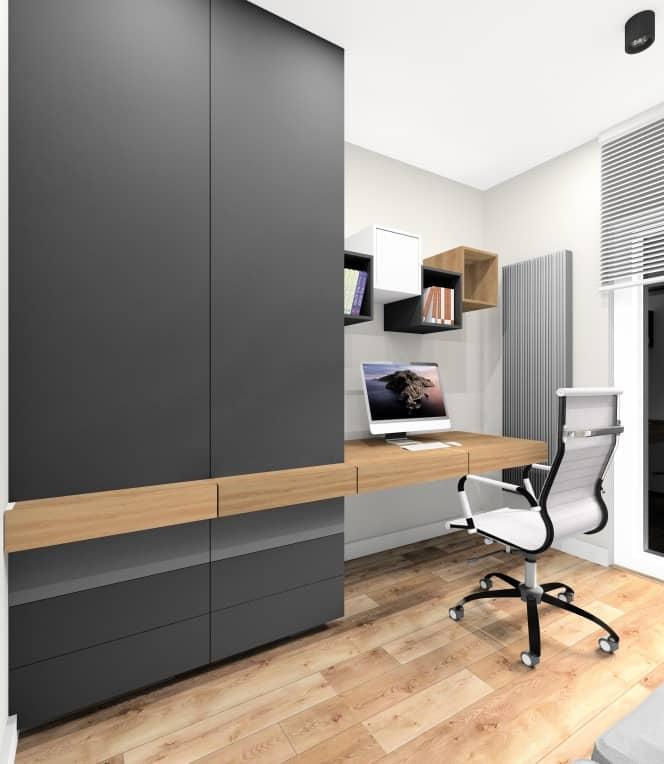Domowe biuro w mieszkaniu w bloku. Sposób na aranżacje wnętrza, biurko w kolorze drewnianym, zabydowa szaf w kolorze grafitowym, szarym, drewnianym, sofa dla gości