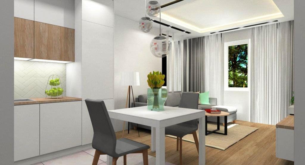 Jasna kolorystyka w małym mieszkaniu, lustra powiększające przestrzeń