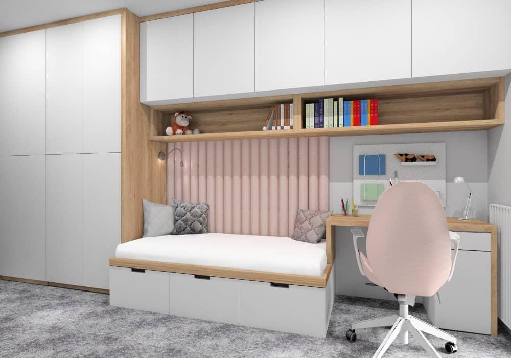 Pokój dla dziewczynki, dziecięcy pokój, biała szafa, drewniane półki, panele tapicerowane za łózkiem w kolorze pudrowy róż, fotel pudrowy róż, na podłodze wykładzina miękka szara