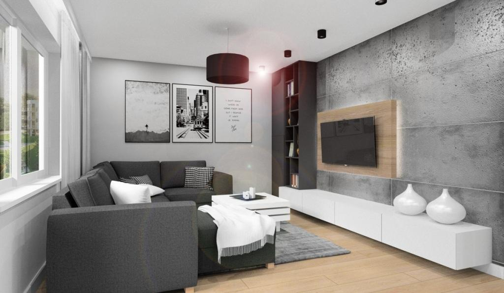 Salon, wystrój nowoczesnego salon, beton na ścianie RTV, szafka RTV biała, duża, półki na książki, szafki na ścianie RTV, duży szary naroznik, czarna lampa, obrazy nowoczesne na ścianie