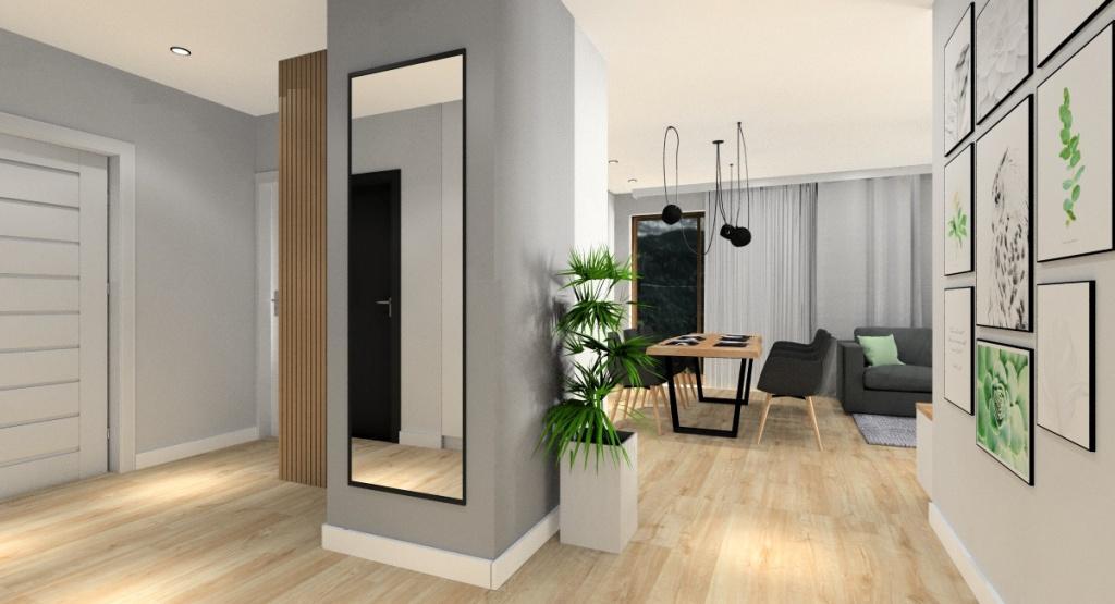 Sposób na optyczne powiększenie przestrzeni w małym mieszkaniu jednolita podłoga w kuchni salonie i hol