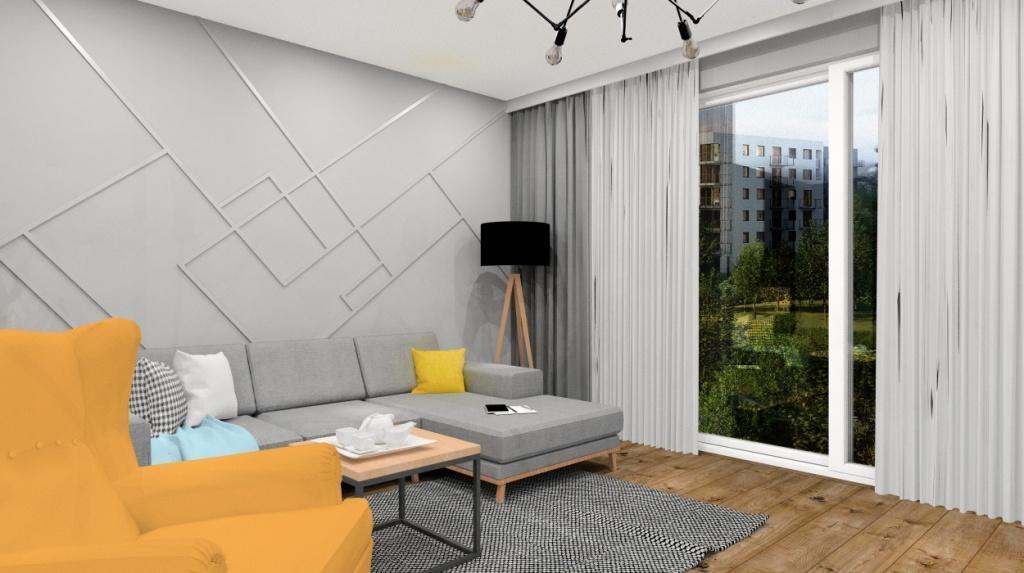 Salon z kuchnią nowoczesny, industrialny, w salonie zółty fotel , sofa narozna szara, dekoracyjna ściana za sofa narożną