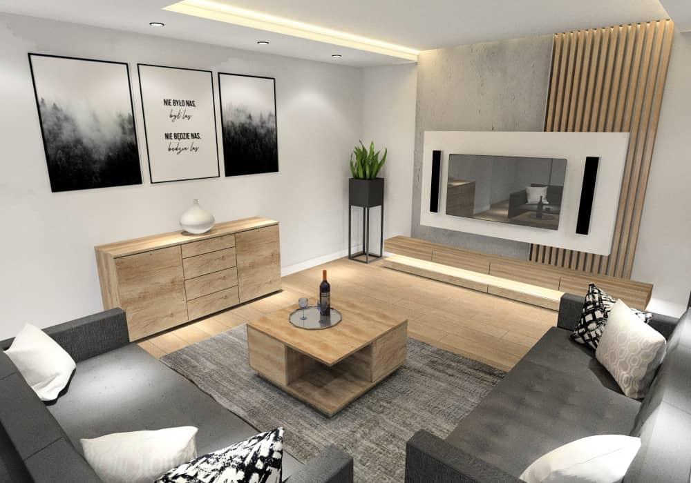 Aranżacja salonu, beton na ścianie TV, drewno szafka TV, komoda drewiana, dwie sofy, sufit podwieszany LED, dodatki czarne plakaty , poduszki białe i czarne