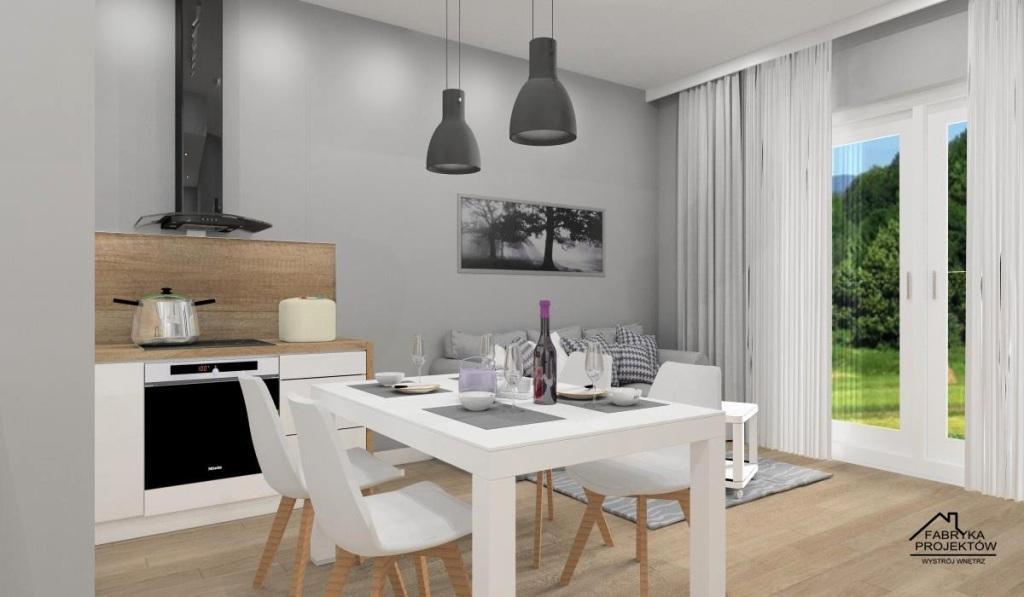 Mieszkanie na wynajem, projekt wnetrza salonu z aneksem, widok na salon z sofą i białą kuchnię