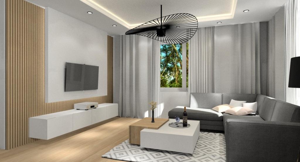 Salon połączony z kuchnią, panele drewniane na ścianie telewizyjnej