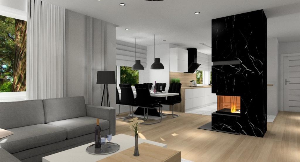 Salon z kuchnią i holem : pomysł na nowoczesne wnętrze, kominek na środku salonu
