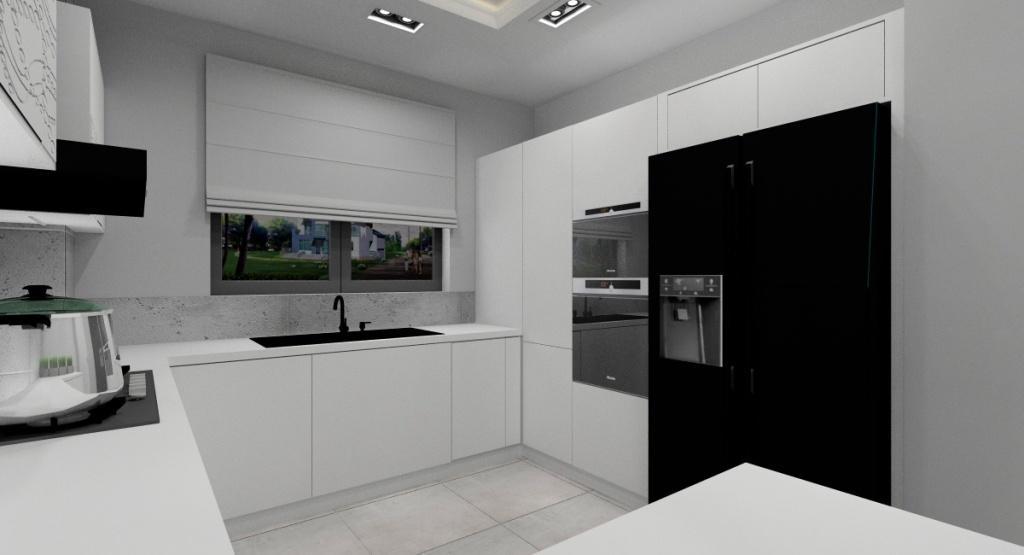 Nowoczesna kuchnia, aranżacja wnętrza małego, płyty betonowe na ścianie, biała zabudowa