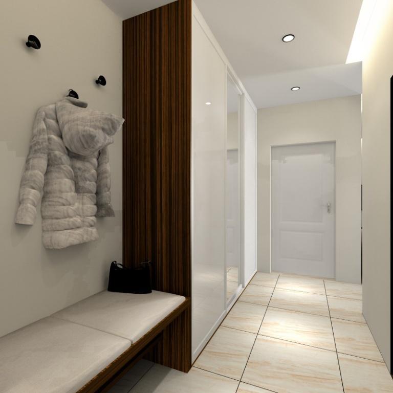 Aranżacja małego mieszkania, przedpokój, duża szafa z lustrem, siedzisko tapicerowane, sufit podwieszany