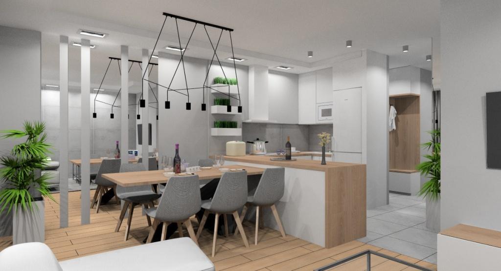 Aranżacja salonu z kuchnią, biała kuchnia z drewnem, drewniany duży stół, lustra w jadalni, beton na ścianie w kuchni