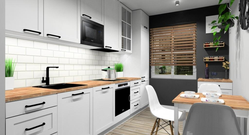 Kuchnia zaprojektowana w stylu skandynawskim, Biała Kuchnia, drewniany blat, ściana grafitowa z półkami na przyprawy, białe małe płytki cegiełki na ścianie