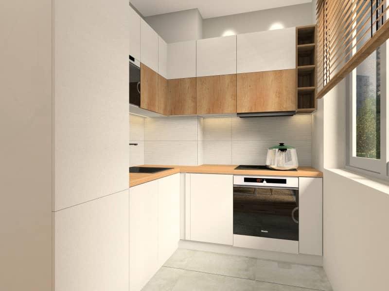 Kuchnia w mieszkaniu na wynajem, aranżacja mebli w kolorze białym z dodatkiem drewna