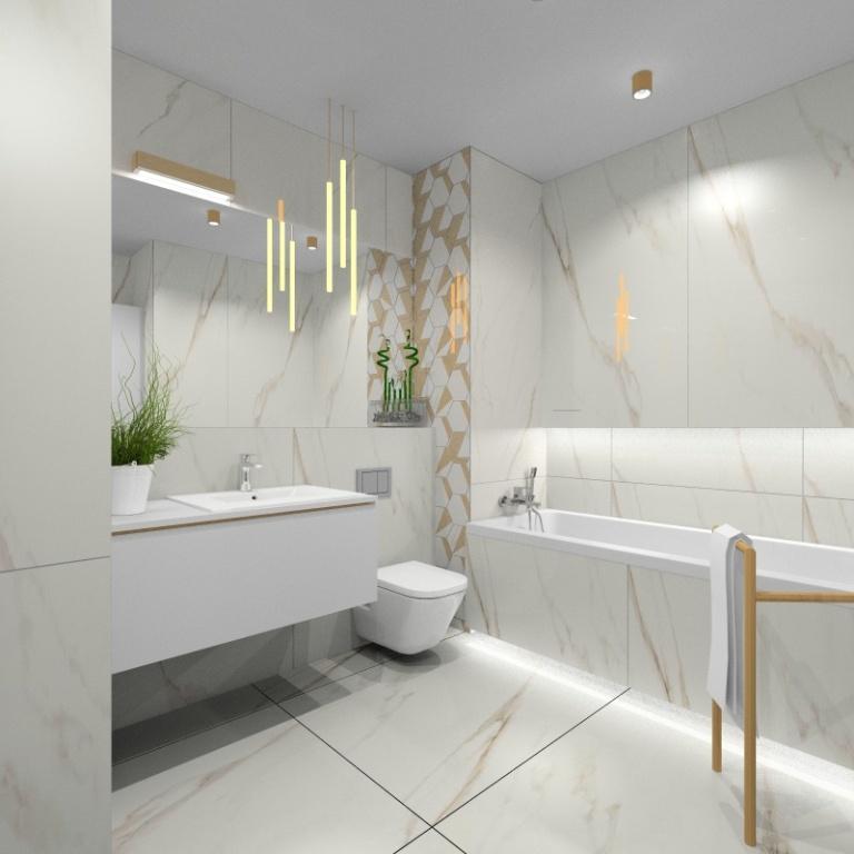Łazienka nowoczesna, białe płytki ceramiczne ze złotem imitujące kamień, duża szafka biała pod umywalkę, wanna prostokątna zabudowana, biała łazienka ze złotymi dodatkami