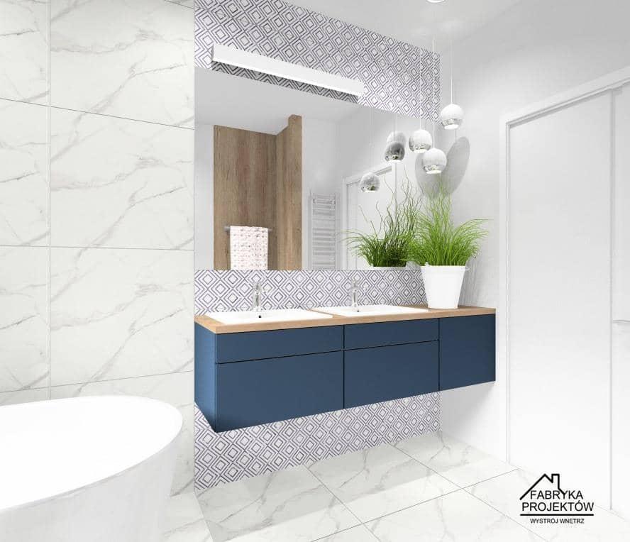 Łazienka z marmurem i granatem, projekt wnętrz z szafką w kolorze granatowym, płytki na ścianie marmur