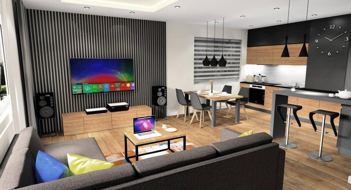 Salon z aneksem kuchennym, pomysł na aranżacje wnętrza, projekt w stylu nowoczesnym, czarne panele na ścianie, czarne lamy, meble kuchenne czarne, drewno
