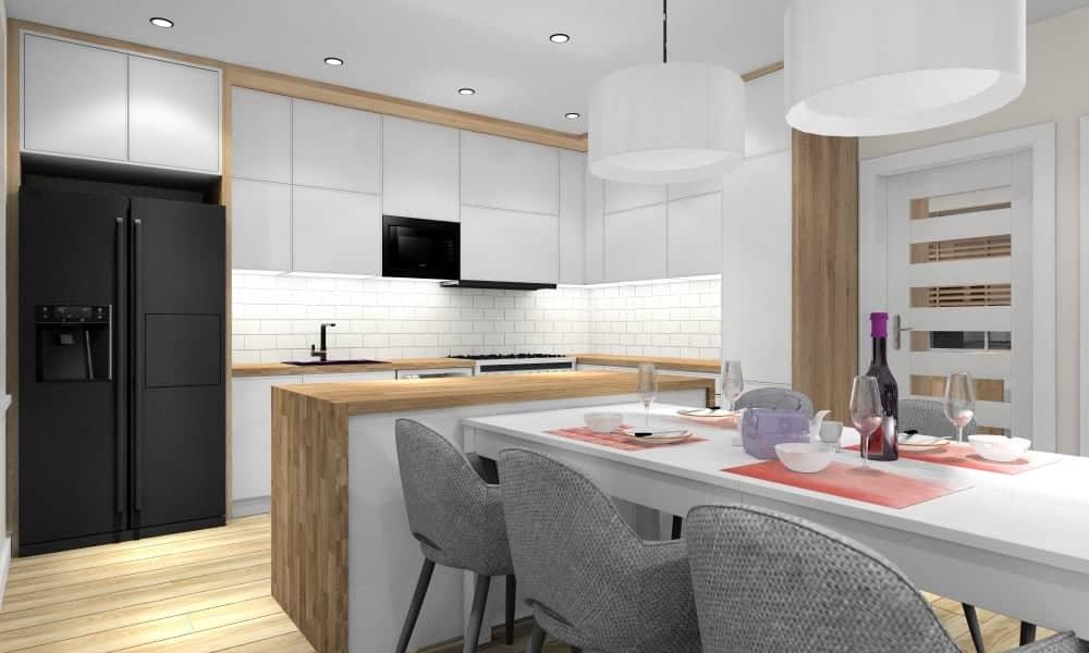Salon, kuchnia, jadalnia, biała kuchnia, drewniane blaty, białe płytki na ścianie