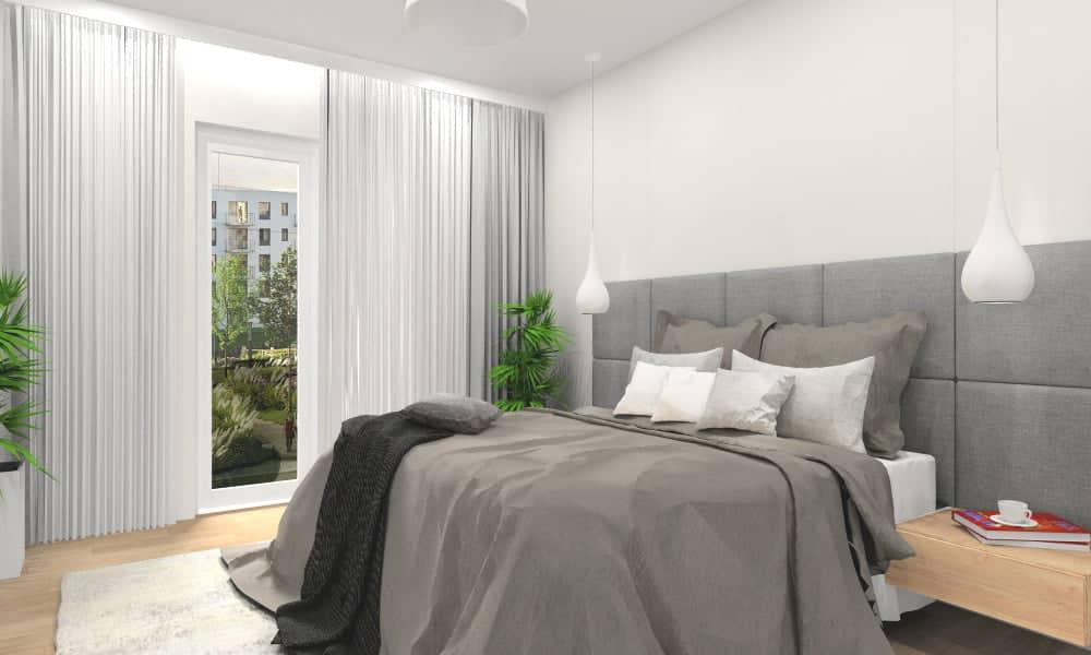Sypialnia w małym mieszkaniu, łózko z zagłowkiem tapiecerowanym