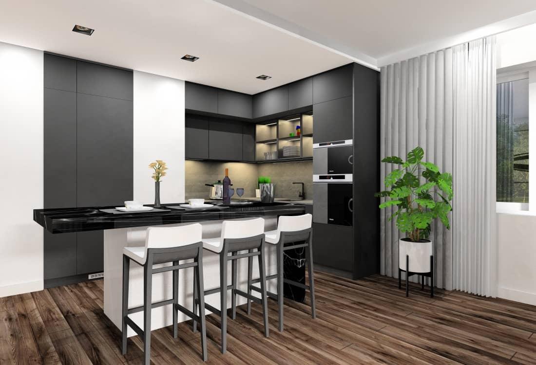 Mała kuchnia, pomysł na projekt wnętrz, grafit blat, przeszkolne szafki górne, wyspa z marmurowym blatem czarnym, białe szafki dolne, czarny sprzęt AGD kuchnia w kolorze szary