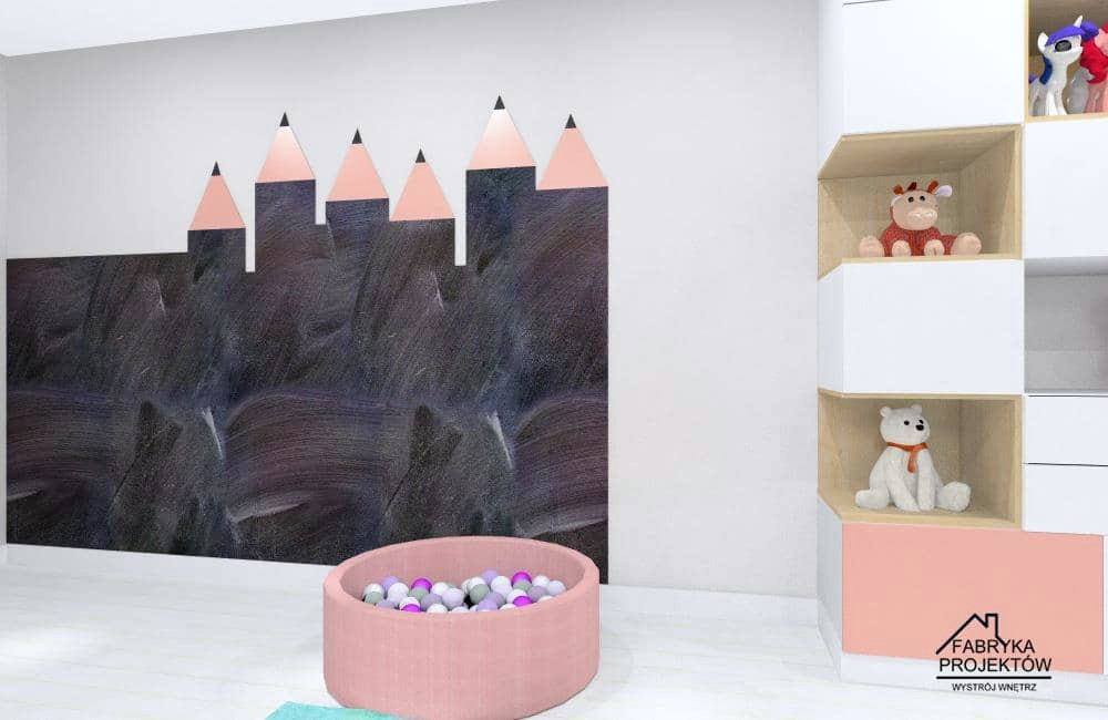 Pomysł na ścianę w pokoju dziewczynki: ściana pomalowana farbą tablicową w kształcie kredek
