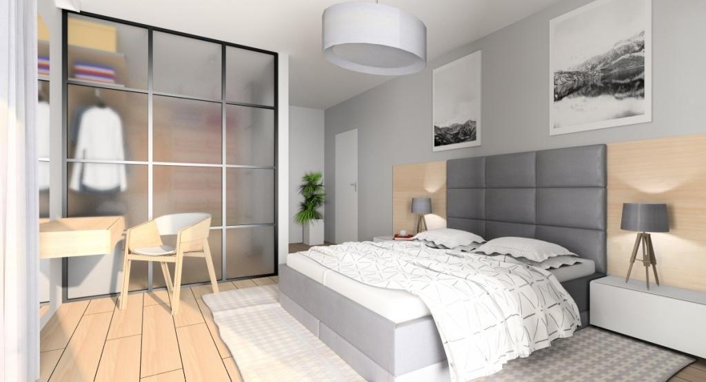 Drewno, szarość i biel w sypialni z garderobą, łóżko kontynentalne, toaletka, plakaty, szafki nocne, dywan szary