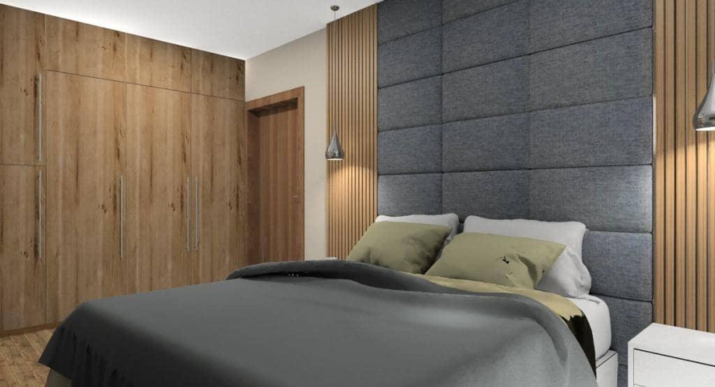 Sypialnia z panelami tapicerowanymi i drewnem na ścianie
