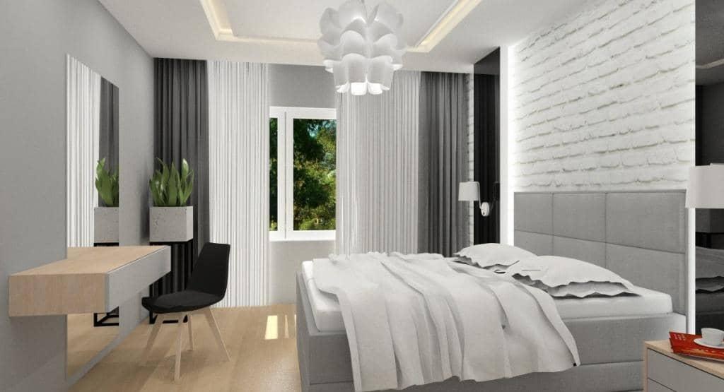Sypialnia z cegłą na ścianie