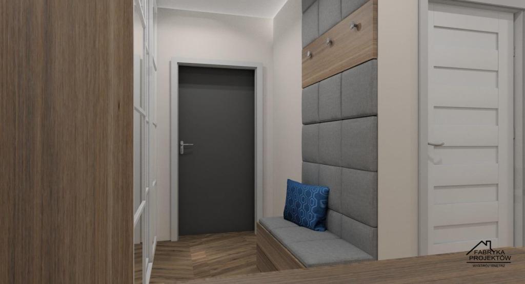 Aranżacja przedpokoju, szafa z drzwiami przesuwnymi, siedzisko z szarym oparciem tapicerowanym, szafka na buty