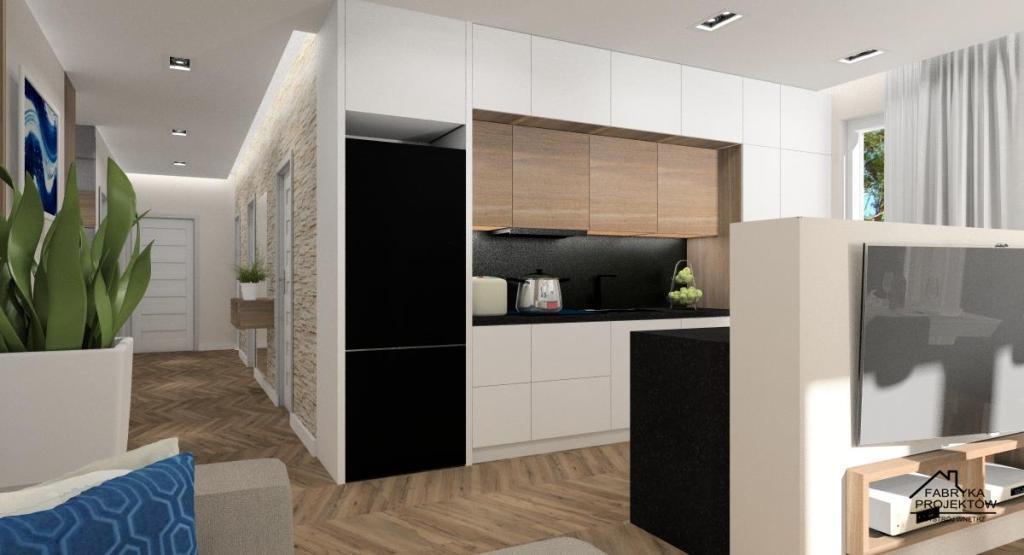 Urządzamy salon z aneksem kuchennym , meble kuchenne białe z drewnem, wyspa połaczona ze ścianką na której znajduje się telewizor